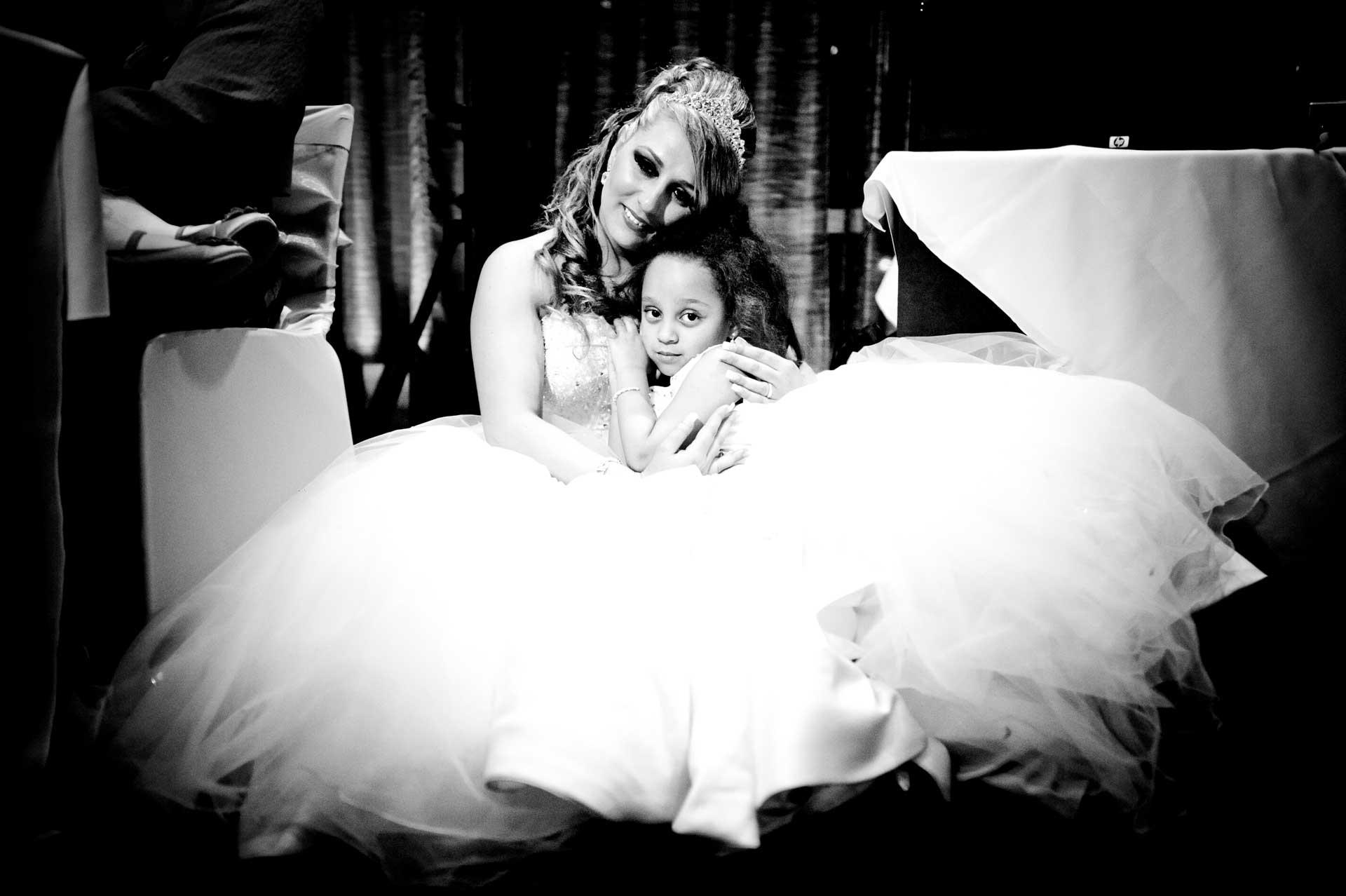 newlywed and daughter hug
