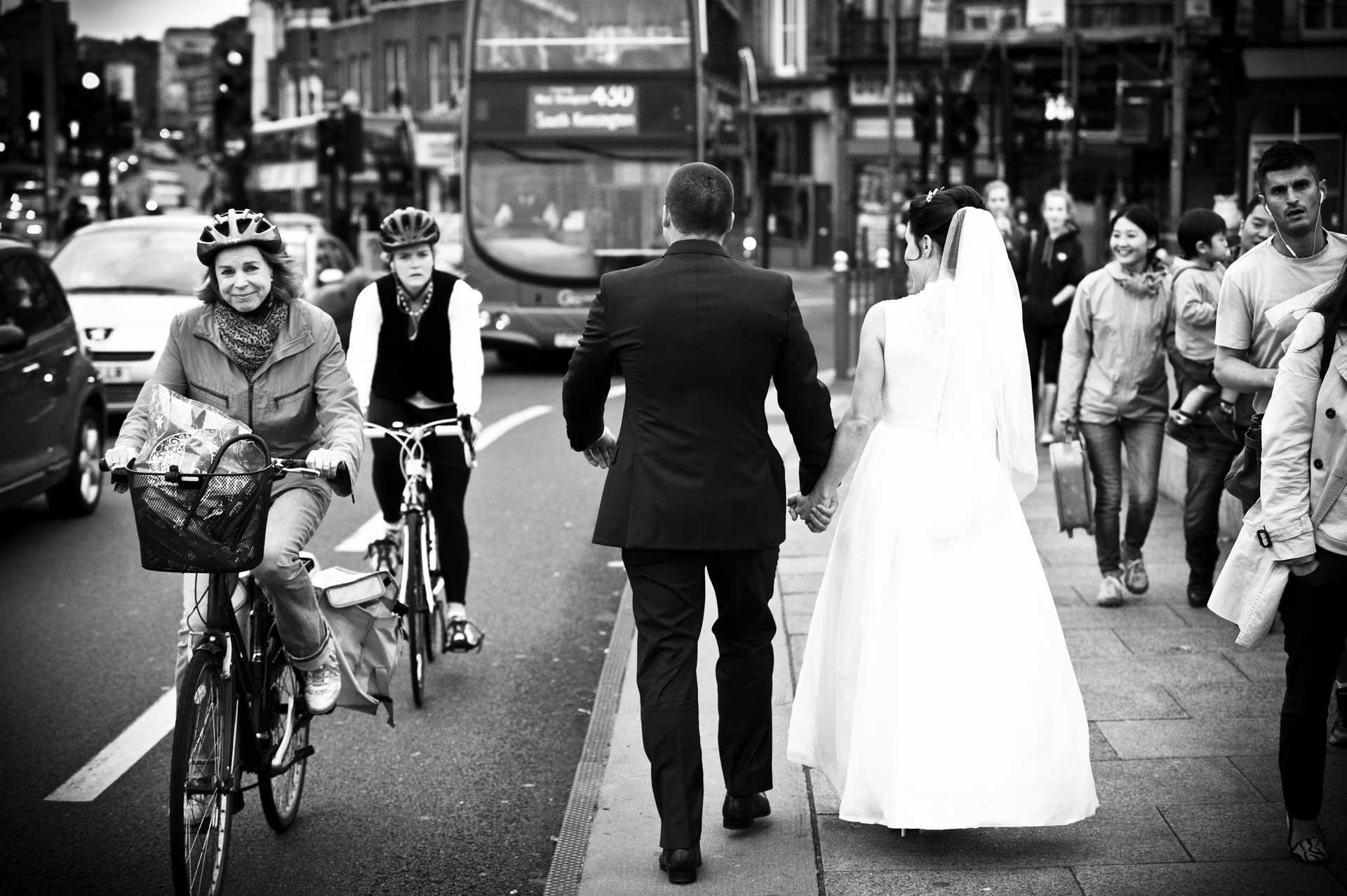 newlyweds walk over putney bridge