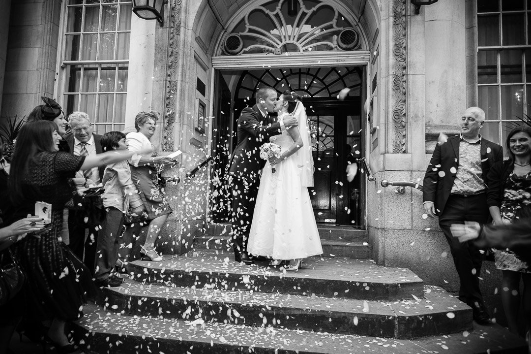bride and groom and confetti at to pop steps