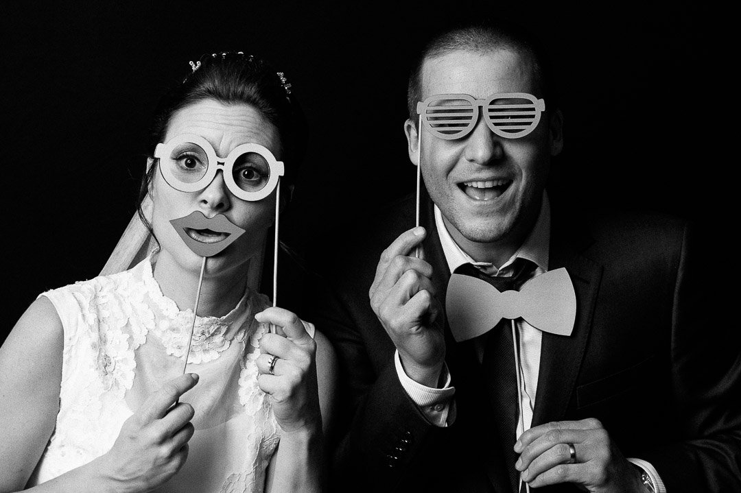 newlyweds in a photo booth