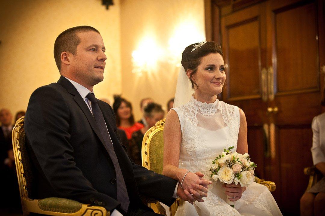 bride and groom listen to the registrar